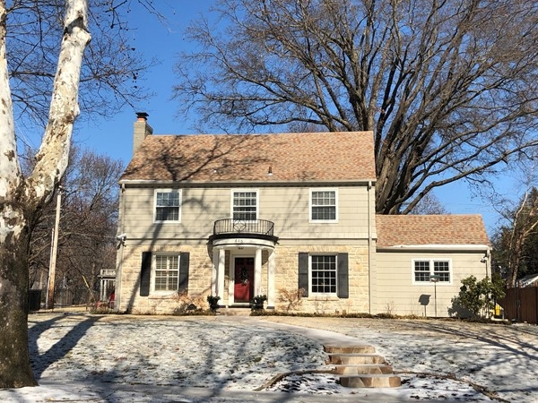 Huge lot with a lovely traditional, two story home in none other but Romanelli Gardens in Brookside