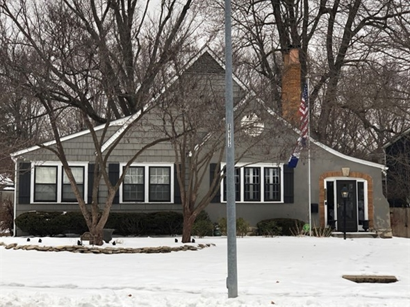 Grey, wintry day but love our American flag in the front of this Brookside home