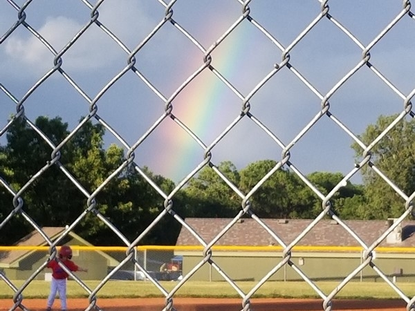 A rainbow in the backdrop for today's game, in Greenwood