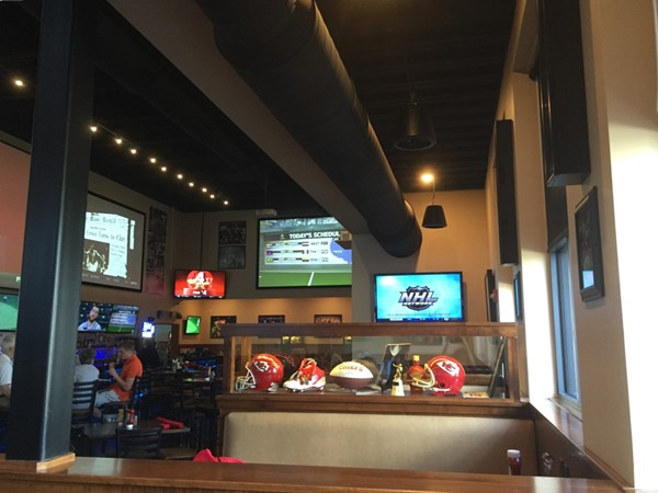 Along with giant TVs and great food, 810Zone features many kinds of sports memorabilia
