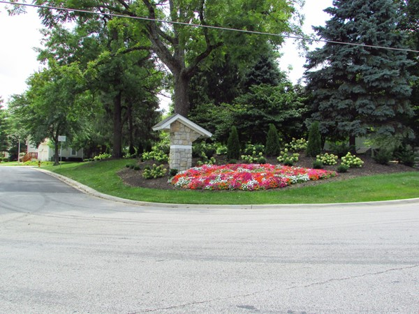 Eastern entrance marker with lush landscaping
