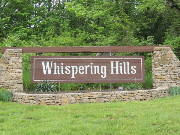 Entrance to Whispering Hills Subdivision in Lenexa, KS.