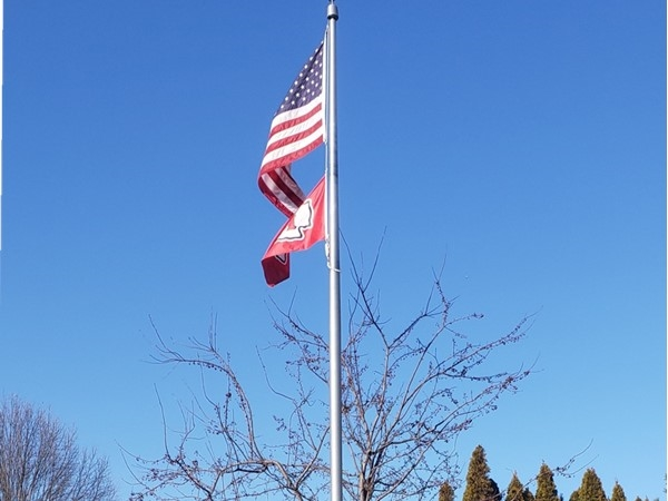 Unseasonably sunny and warm day in January with the flag flying high