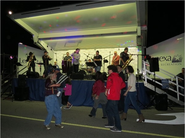 Live music Friday night at the Lenexa Chili Challenge. Note the full moon at the upper left