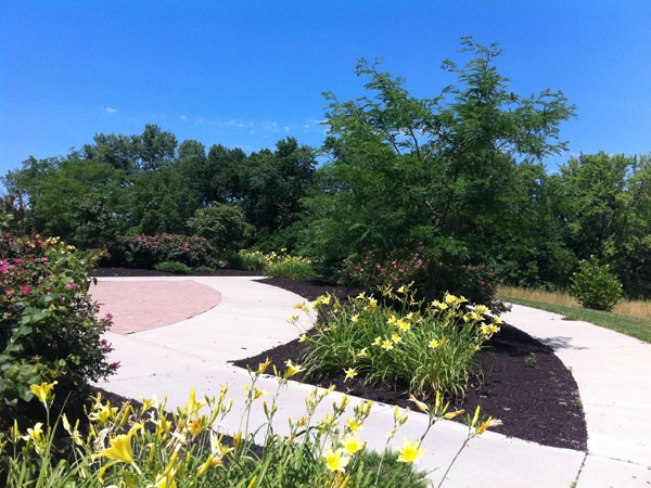 Flower gardens at the market circle invite visitors to slow down and smell the roses!
