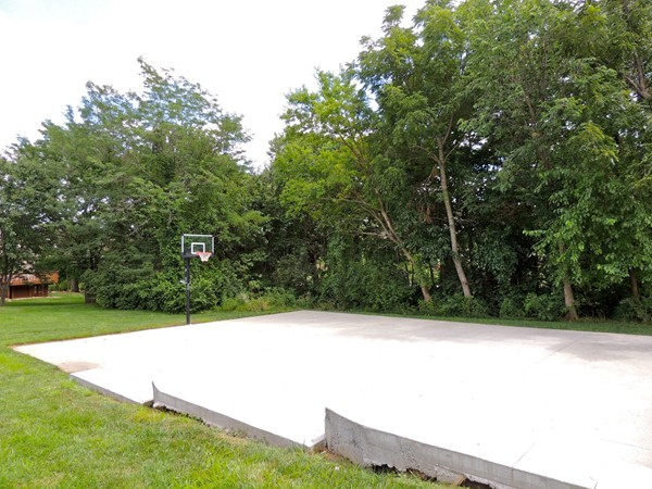 Basketball court located near the pool, playground, and walking trail