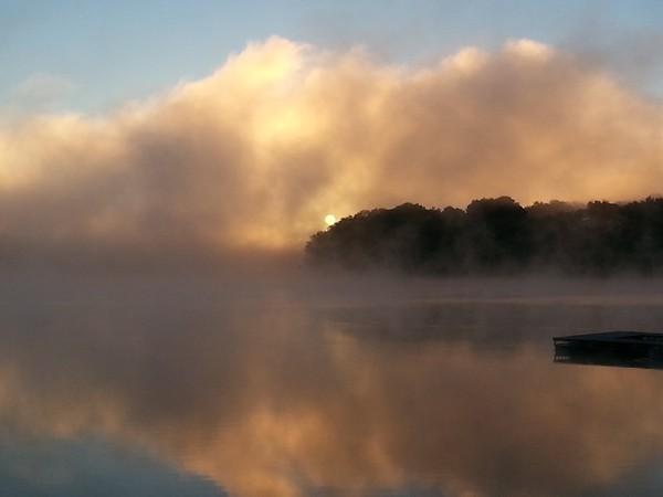 A September morning with fog lifting off of Riss Lake