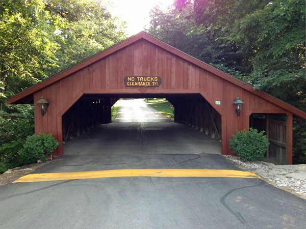The Covered Bridge entrance to Whispering Hills is a unique subdivision landmark