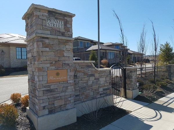 One of the attractive entrances to Prairiefire Villas at Lionsgate