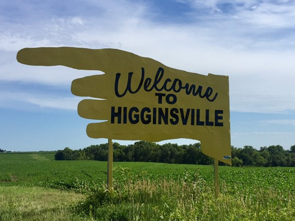 A large yellow sign points the way to Higginsville