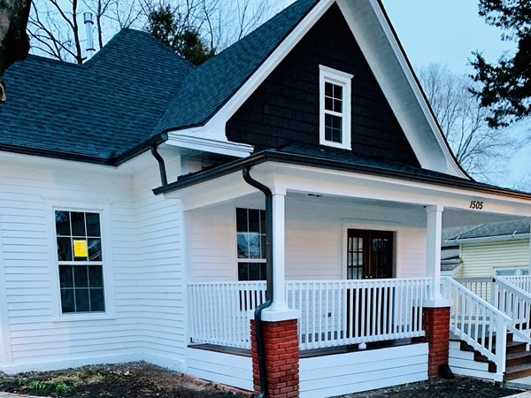 Live the farmhouse lifestyle in the heart of downtown Blue Springs. Charming