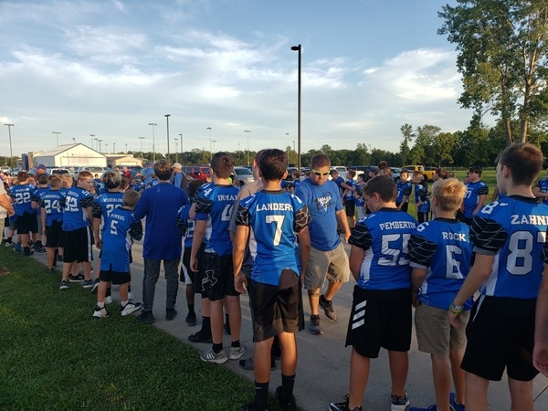 The youth football league waiting for our Grain Valley Eagles football team to cheer them on