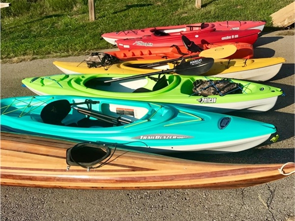 A rainbow of kayaks ready for fun on Lake Remembrance