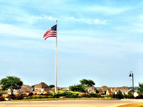 This beautiful flag will greet you morning and evening, if you live in this lovely subdivision
