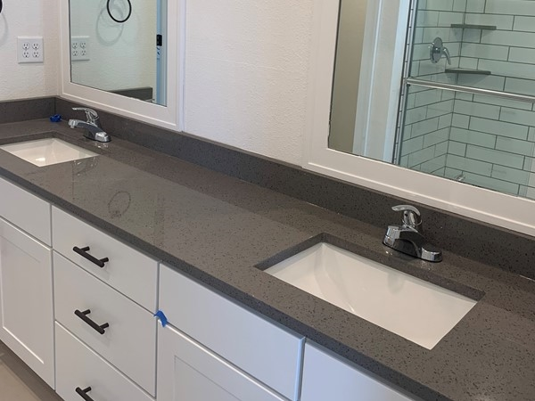 Nicely done master baths with quartz and subway tile