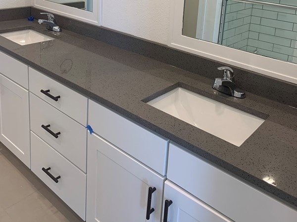 Double vanity in the master, tiled shower and soft-close drawers