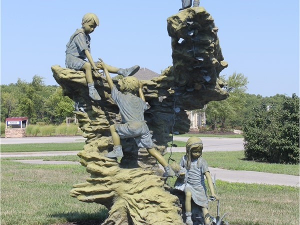 Children at play. A statue in Seven Bridges with character