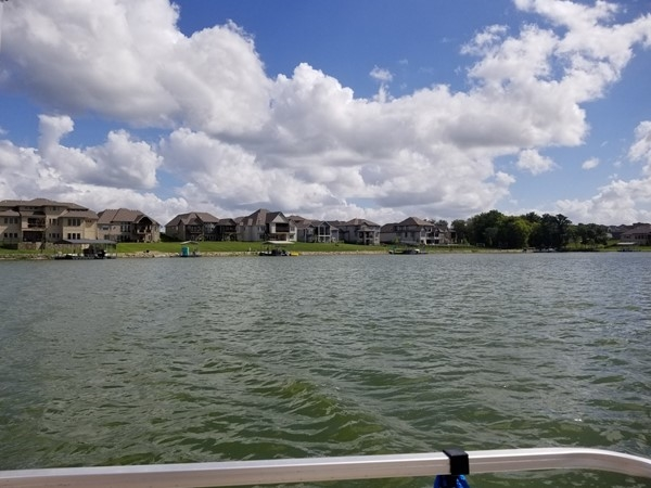 Life is always a little bit better on a boat at Creekmoor Subdivision, in Raymore, Missouri