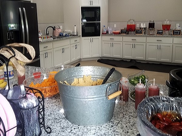 Clubhouse rental provides seating for around 75 people and a kitchen area for food prep & service