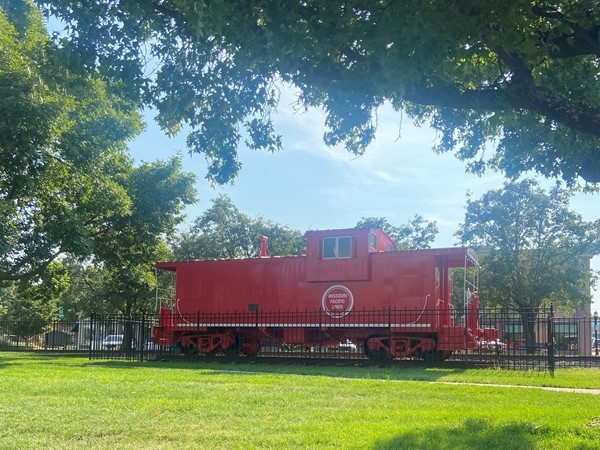 Big, historic red train in Downtown Lee's Summit located across the street from the Whistle Stop
