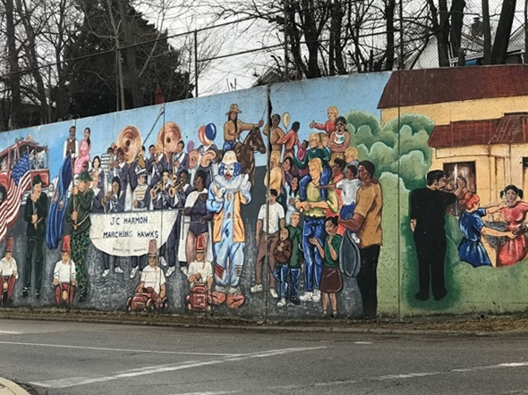The painted cultural mural at 30th and Metropolitan Ave