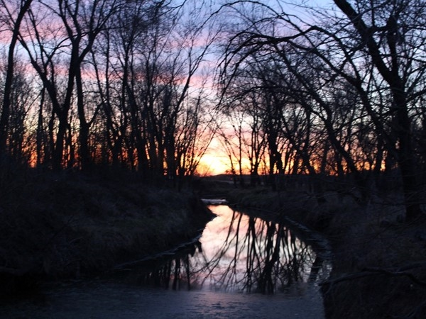 Sunset over Rush Creek at English Landing Park in Parkville