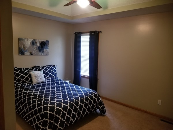 A beautifully staged bedroom in Blue Springs