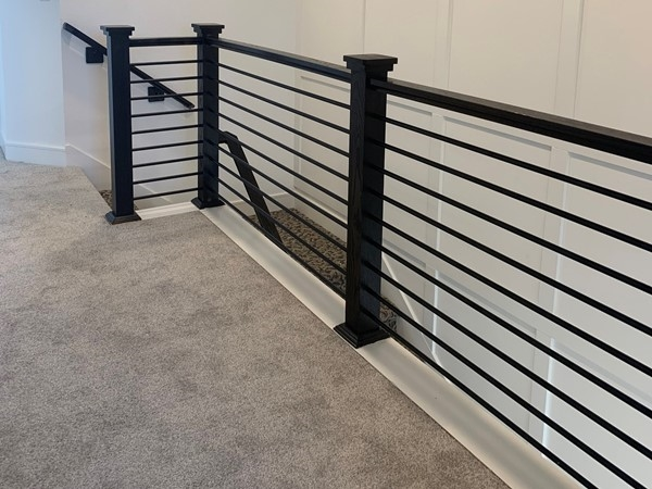 Horizontal handrail gives it a contemporary flair