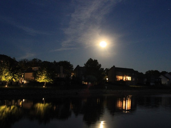 Beautiful full moon above the fishing ponds in Monarch View