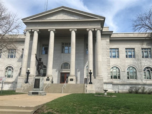 """Historic Leavenworth Courthouse displays a statue of a WWI """"Doughboy"""" at the front entrance"""