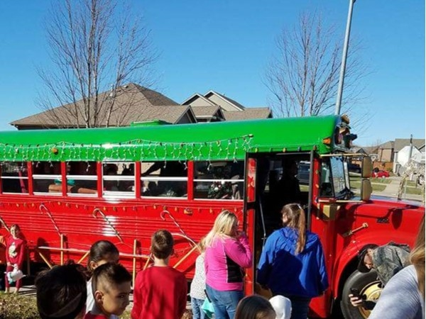 Santa Bus going from neighborhood to neighborhood bringing joy to all the boys and girls