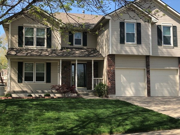 Love this 2 story home with tons of mature trees in North Brook