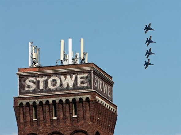 Navy Blue Angels perform above the historic Stowe Hardware & Supply Company Building