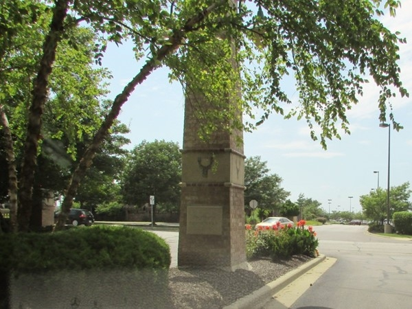 The secondary entrance to the subdivision is immediately adjacent to Deer Creek Marketplace