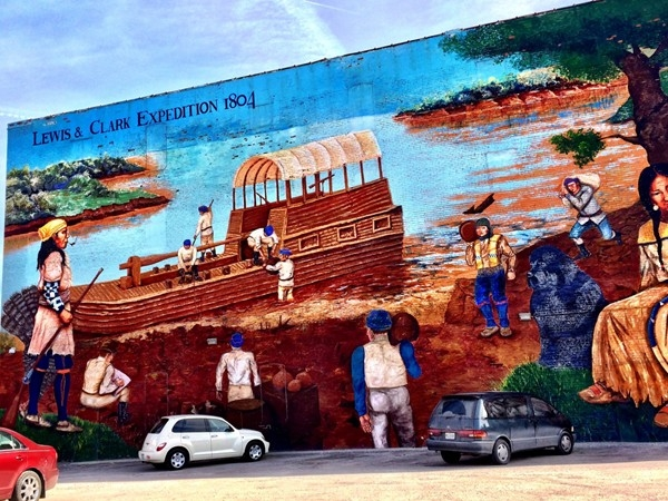 Colorful murals decorate and tell stories on various buildings in the downtown Kansas City area