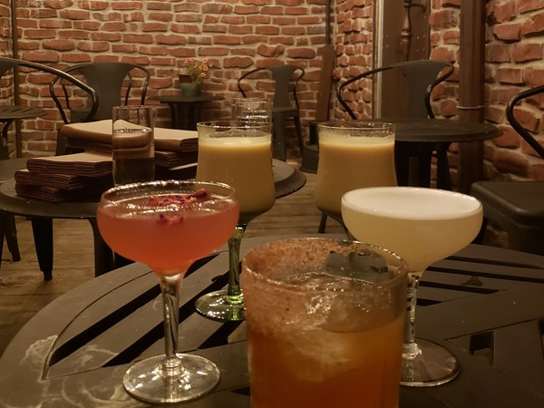 The patio area and delicious drinks at The W Bar in Downtown Lee's Summit