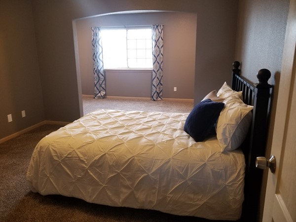 A staged master bedroom at Shadow Glen Townhomes by Staging Dreams