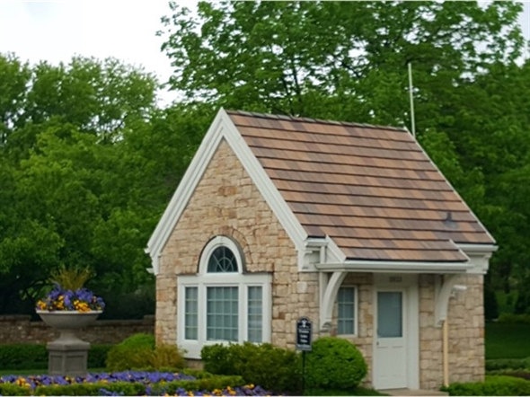 This miniature house sits at the entrance of Hallbrook Farms as if to greet happy residents