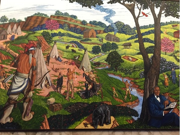 One of the murals hanging in the Clay County Courthouse on the 3rd floor, depicts the Iowa Tribe