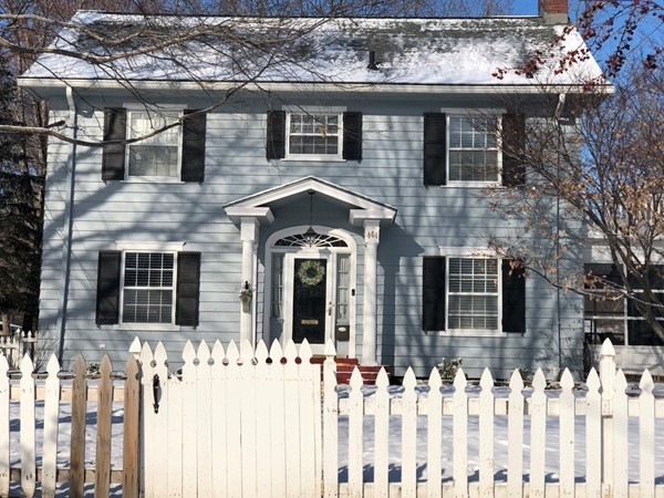 Exceptional true two story historic home, love the picket fence