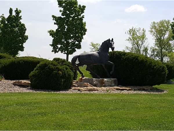 This young colt looks like he's hiding in the bushes. One of the many statues in Saddlridge Estates