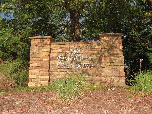 Monument sign at the entrance of Oak Tree Meadows