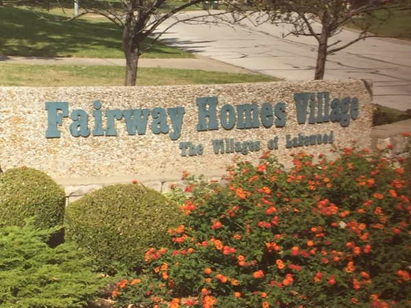 Fall flowers at Fairway Homes Village entrance