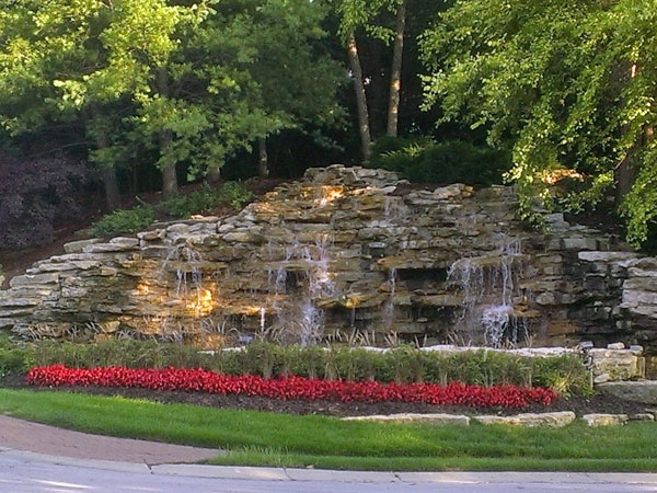 Graced with fountains and waterfalls with stone trim and accents