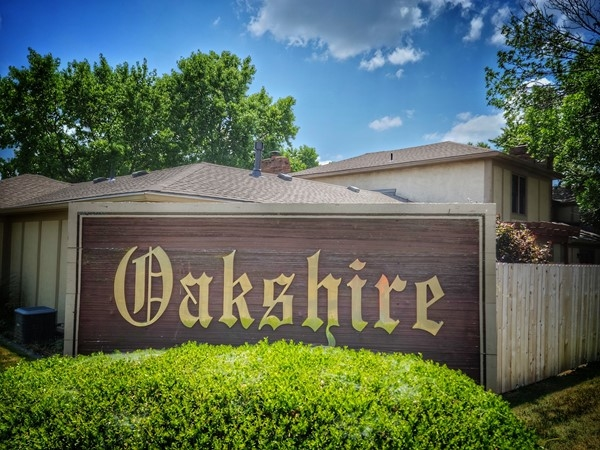 Entrance sign to Oakshire Townhome Subdivision near Oak Park Mall