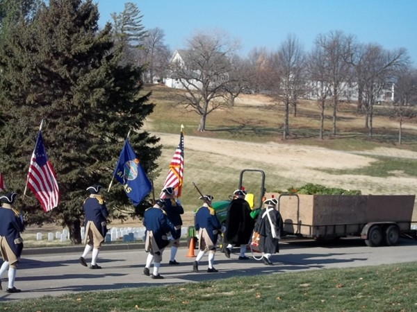 SAR color guard leads Wreaths across America volunteers decorate Leavenworth National Cemetary