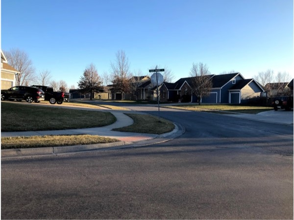 The clean and well-maintained neighborhood of Plum Creek Estates
