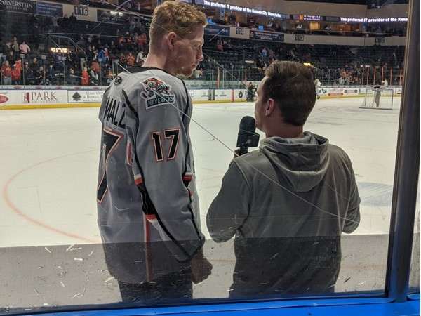 Mavericks Hockey player being interviewed after a big win