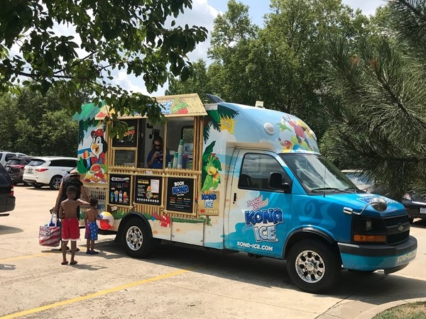 "The neighborhood hosted a ""End of Summer"" pool party and had the Kona Ice truck for free treats"