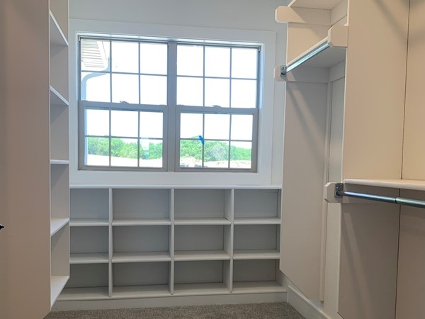 All kinds of space and cubbies in the Master closet and the laundry room connects
